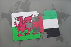 Puzzle with the national flag of wales and united arab emirates on a world map. Background. 3D illustration Royalty Free Stock Photography