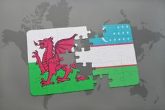 Puzzle with the national flag of wales and uzbekistan on a world map. Background. 3D illustration Stock Images