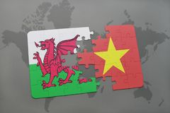 Puzzle with the national flag of wales and vietnam on a world map. Background. 3D illustration Stock Photos