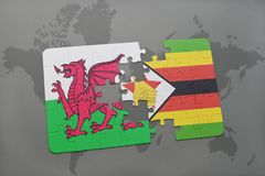 puzzle with the national flag of wales and zimbabwe on a world map Royalty Free Stock Photos