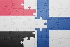 Puzzle with the national flag of yemen and finland Royalty Free Stock Photography
