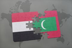 Puzzle with the national flag of yemen and maldives on a world map background. Stock Photo