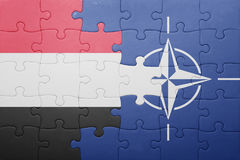 Puzzle with the national flag of yemen and nato Stock Photo