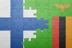 Puzzle with the national flag of zambia and finland. Puzzle with the national flag of zambia and  finland. concept Royalty Free Stock Photos
