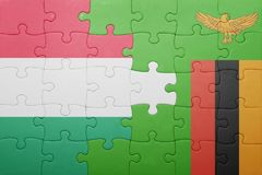 Puzzle with the national flag of zambia and hungary Stock Images