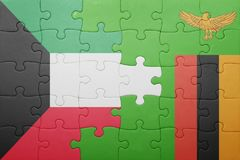 Puzzle with the national flag of zambia and kuwait. Concept Stock Photo