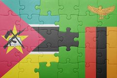 Puzzle with the national flag of zambia and mozambique Stock Images