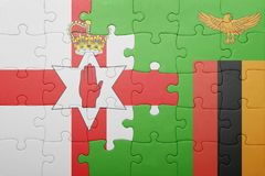 Puzzle with the national flag of zambia and northern ireland. Concept Stock Photo