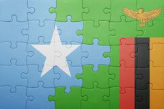 Puzzle with the national flag of zambia and somalia. Concept Royalty Free Stock Photos