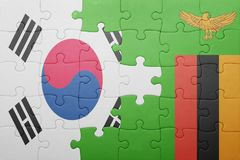 Puzzle with the national flag of zambia and south korea. Concept royalty free stock images