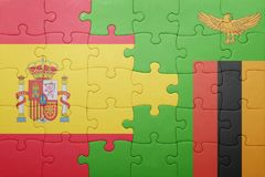 Puzzle with the national flag of zambia and spain Stock Image
