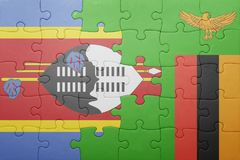 Puzzle with the national flag of zambia and swaziland Stock Image