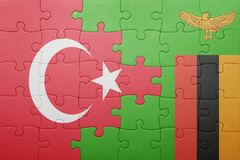 Puzzle with the national flag of zambia and turkey. Concept stock images