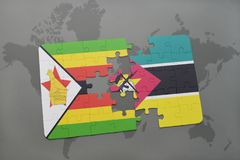 Puzzle with the national flag of zimbabwe and mozambique on a world map Royalty Free Stock Photo