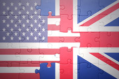 Puzzle with the national flags of united states of america and great britain. Puzzle with the national flag of united states of america and great britain Royalty Free Stock Image