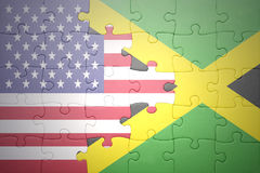 Puzzle with the national flags of united states of america and jamaica. Puzzle with the national flag of united states of america and  jamaica.concept Stock Photography