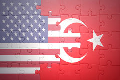 Puzzle with the national flags of united states of america and turkey Royalty Free Stock Photography