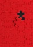 Puzzle nel colore rosso Immagine Stock Libera da Diritti