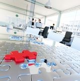 Puzzle in office represents business solutions Stock Photo