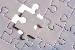 Puzzle with one piece missing Royalty Free Stock Photo