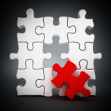 Puzzle with one red part missing Royalty Free Stock Photography