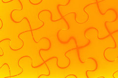 Puzzle in orange Royalty Free Stock Photography
