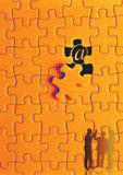 puzzle in orange Stock Photography