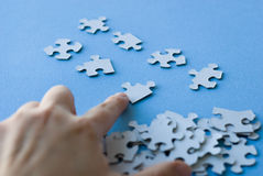 Puzzle organized by hand Stock Images