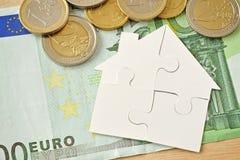 Puzzle house over money euro background. Puzzle paper house over money euro background Royalty Free Stock Photography