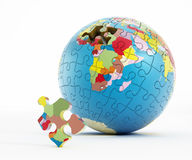Puzzle parts forming Earth Stock Photo