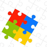 Puzzle parts for teamwork. Puzzle with four colored parts symbolizing teamwork and togetherness Stock Photography