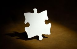 Puzzle Piece. Photo of a White Puzzle Piece Stock Images
