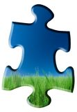 Puzzle Piece. Large puzzle piece with green grass at the bottom, blue sky above.  Isolated on white background Royalty Free Stock Photography