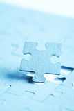 Puzzle piece. Focus on the lower section of the puzzle Stock Image