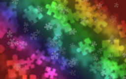 Puzzle piece Bokeh background. Puzzle pieces Bokeh effect used as a blurred background Stock Photos