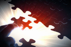 Puzzle pieces. Puzzle piece coming down into its place stock photos