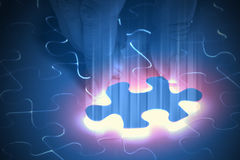 Puzzle pieces. Puzzle piece coming down into its place royalty free stock image