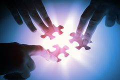 Puzzle pieces. Puzzle piece coming down into its place stock photography