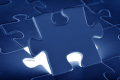 Puzzle piece coming down into it's place. Puzzle piece, coming down into it's place stock images