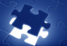 Puzzle piece coming down into it's place. Puzzle piece, coming down into it's place royalty free stock images