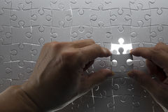 Puzzle piece. Coming down into it's place stock image