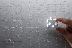Puzzle piece. Coming down into it's place royalty free stock photo