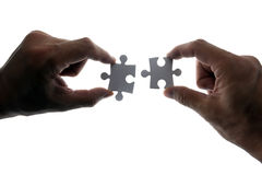 Puzzle piece. Coming down into it's place royalty free stock image