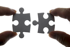 Puzzle piece. Coming down into it's place stock photos