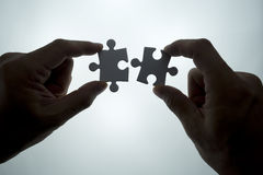 Puzzle piece. Coming down into it's place royalty free stock photography