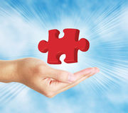 Puzzle Piece in Hand. 3D 3 Dimensional illustration puzzle piece in hand with blue cool sky background Royalty Free Stock Image