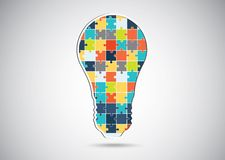 Puzzle piece light idea bulb. Stock Image