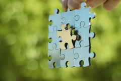Puzzle piece link business. One link is very important. Business concept Stock Photography