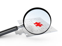 Puzzle Piece with Magnifying Glass Stock Images