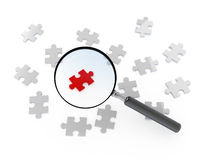 Puzzle Piece with Magnifying Glass Royalty Free Stock Photos